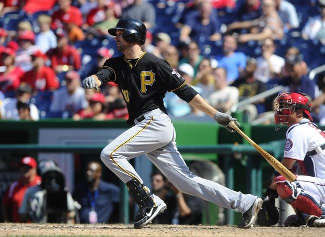 Jul 25, 2013; Washington, DC, USA; Pittsburgh Pirates second baseman Jordy Mercer (10) hits an RBI single during the ninth inning against the Washington Nationals at Nationals Park.  Mandatory Credit: Brad Mills-USA TODAY Sports