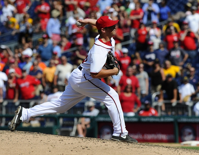 Jul 25, 2013; Washington, DC, USA; Washington Nationals relief pitcher Ian Krol (46) throws during the ninth inning against the Pittsburgh Pirates at Nationals Park. Mandatory Credit: Brad Mills-USA TODAY Sports