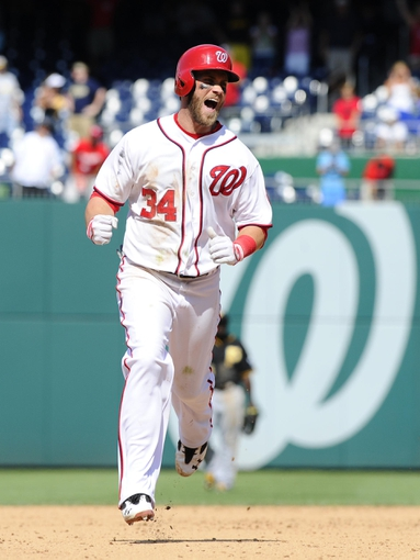 Jul 25, 2013; Washington, DC, USA; Washington Nationals center fielder Bryce Harper (34) celebrates after hitting a walk-off two run home run during the ninth inning against the Pittsburgh Pirates at Nationals Park. Mandatory Credit: Brad Mills-USA TODAY Sports