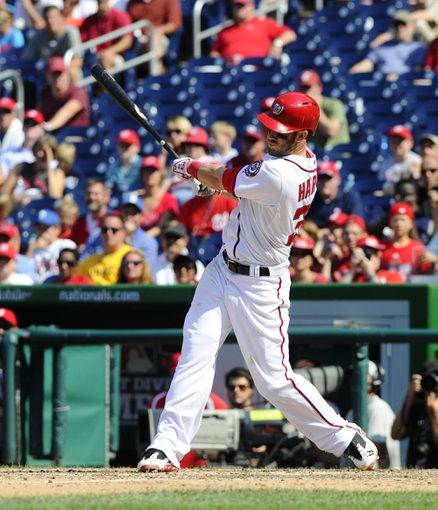 Jul 25, 2013; Washington, DC, USA; Washington Nationals center fielder Bryce Harper (34) hits a walk-off two run home run during the ninth inning against the Pittsburgh Pirates at Nationals Park. Mandatory Credit: Brad Mills-USA TODAY Sports