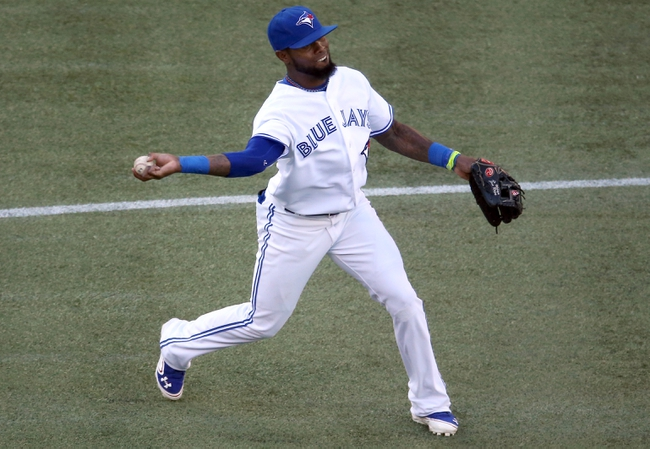 Jul 25, 2013; Toronto, Ontario, CAN; Toronto Blue Jays shortstop Jose Reyes (7) throws out the baserunner in the first inning against the Houston Astros at Rogers Centre. Mandatory Credit: Tom Szczerbowski-USA TODAY Sports