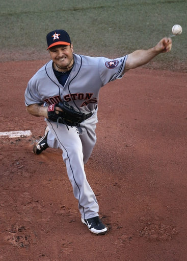 Jul 25, 2013; Toronto, Ontario, CAN; Houston Astros starting pitcher Erik Bedard (45) delivers a pitch against the Toronto Blue Jays at Rogers Centre. Mandatory Credit: Tom Szczerbowski-USA TODAY Sports