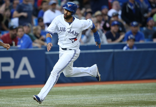 Jul 25, 2013; Toronto, Ontario, CAN; Toronto Blue Jays right fielder Jose Bautista (19) races to score a run in the fourth inning against the Houston Astros at Rogers Centre. Mandatory Credit: Tom Szczerbowski-USA TODAY Sports