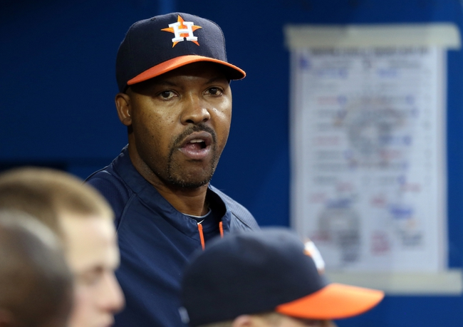 Jul 25, 2013; Toronto, Ontario, CAN; Houston Astros manager Bo Porter (16) looks on from the dugout against the Toronto Blue Jays at Rogers Centre. Mandatory Credit: Tom Szczerbowski-USA TODAY Sports