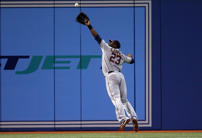 Jul 25, 2013; Toronto, Ontario, CAN; Houston Astros left fielder Chris Carter (23) makes a leaping catch in the seventh inning against the Toronto Blue Jays at Rogers Centre. Mandatory Credit: Tom Szczerbowski-USA TODAY Sports