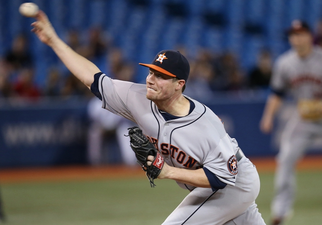 Jul 25, 2013; Toronto, Ontario, CAN; Houston Astros pitcher Lucas Harrell (64) delivers a pitch against the Toronto Blue Jays at Rogers Centre. The Blue Jays beat the Astros 4-0. Mandatory Credit: Tom Szczerbowski-USA TODAY Sports