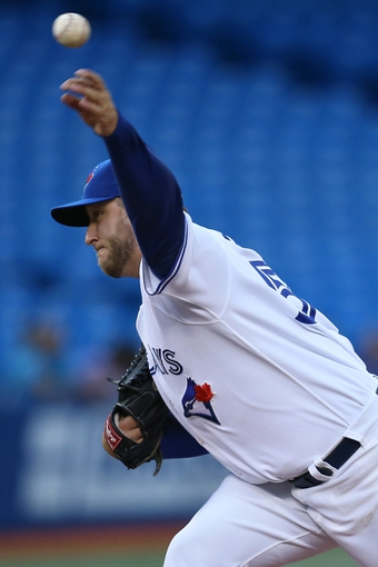 Jul 25, 2013; Toronto, Ontario, CAN; Toronto Blue Jays starting pitcher Mark Buehrle (56) delivers a pitch against the Houston Astros at Rogers Centre. The Blue Jays beat the Astros 4-0. Mandatory Credit: Tom Szczerbowski-USA TODAY Sports