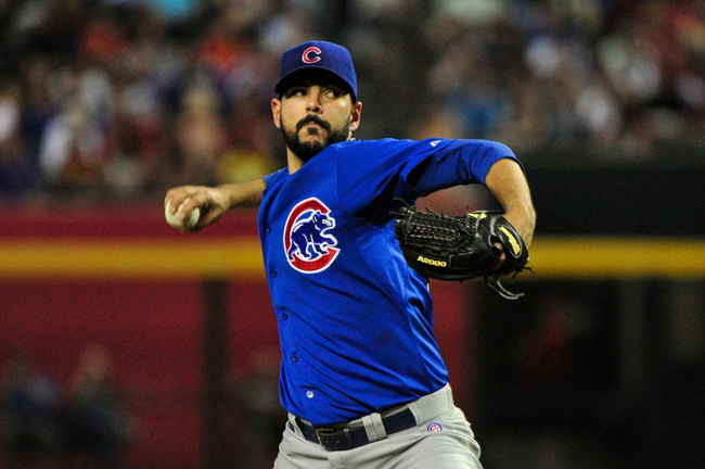 Jul 25, 2013; Phoenix, AZ, USA; Chicago Cubs relief pitcher Carlos Villanueva (33) throws during the fourth inning against the Arizona Diamondbacks at Chase Field. Mandatory Credit: Matt Kartozian-USA TODAY Sports