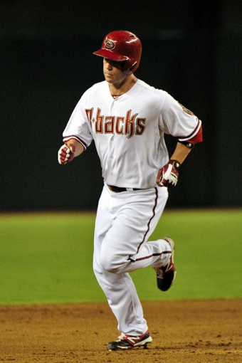 Jul 25, 2013; Phoenix, AZ, USA; Arizona Diamondbacks second baseman Aaron Hill (2) rounds second base after hitting a solo home run during the fifth inning against the Chicago Cubs at Chase Field. Mandatory Credit: Matt Kartozian-USA TODAY Sports