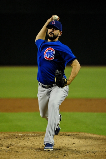 Jul 25, 2013; Phoenix, AZ, USA; Chicago Cubs starting pitcher Carlos Villanueva (33) throws during the first inning against the Arizona Diamondbacks at Chase Field. Mandatory Credit: Matt Kartozian-USA TODAY Sports
