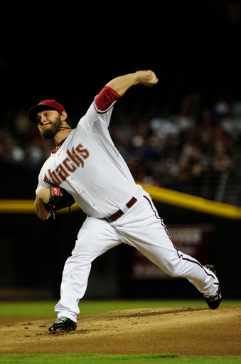 Jul 25, 2013; Phoenix, AZ, USA; Arizona Diamondbacks starting pitcher Wade Miley (36) throws during the first inning against the Chicago Cubs at Chase Field. Mandatory Credit: Matt Kartozian-USA TODAY Sports