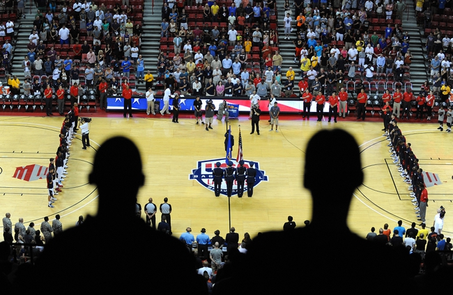 Jul 25, 2013; Las Vegas, NV, USA; Fans and players from Team USA Men's Basketball team stand at attention during the presentation of colors by the Nellis Air Force Base Honor Guard before the start of the 2013 USA Basketball Showcase at the Thomas and Mack Center. Mandatory Credit: Stephen R. Sylvanie-USA TODAY Sports