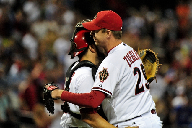 Jul 25, 2013; Phoenix, AZ, USA; Arizona Diamondbacks relief pitcher Brad Ziegler (29) celebrates with catcher Wil Nieves (27) after beating the Chicago Cubs 3-1 at Chase Field. Mandatory Credit: Matt Kartozian-USA TODAY Sports