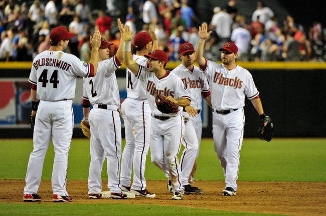 Jul 25, 2013; Phoenix, AZ, USA; Members of the Arizona Diamondbacks celebrate after beating the Chicago Cubs 3-1 at Chase Field. Mandatory Credit: Matt Kartozian-USA TODAY Sports