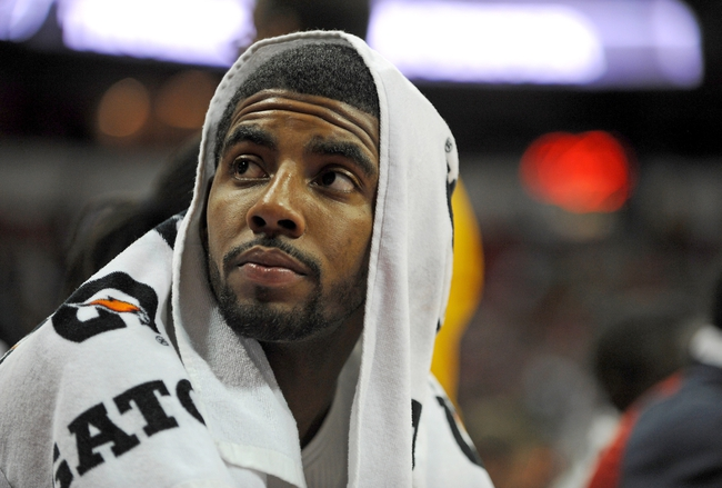 Jul 25, 2013; Las Vegas, NV, USA; USA White Team forward Kyrie Irving looks into the crowd from the bench during the 2013 USA Basketball Showcase at the Thomas and Mack Center. Mandatory Credit: Stephen R. Sylvanie-USA TODAY Sports