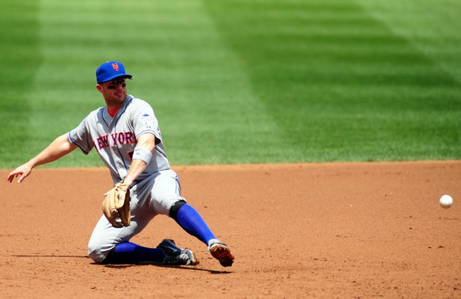 Jul 26, 2013; Washington, DC, USA; New York Mets third baseman David Wright (5) attempts to field a ground ball in the second inning against the Washington Nationals at Nationals Park. Mandatory Credit: Evan Habeeb-USA TODAY Sports