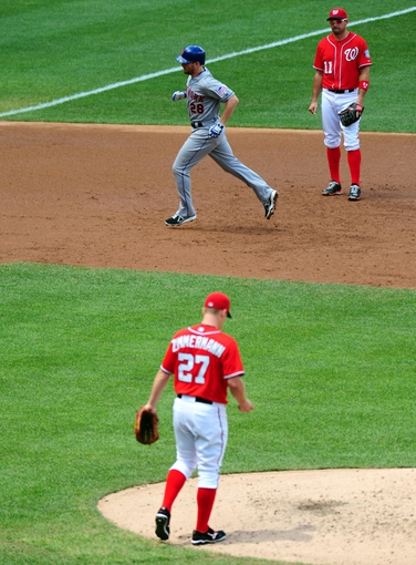 Jul 26, 2013; Washington, DC, USA; New York Mets second baseman Daniel Murphy (28) rounds the bases after hitting his second home run of the day off Washington Nationals pitcher Jordan Zimmermann (27) at Nationals Park. Mandatory Credit: Evan Habeeb-USA TODAY Sports