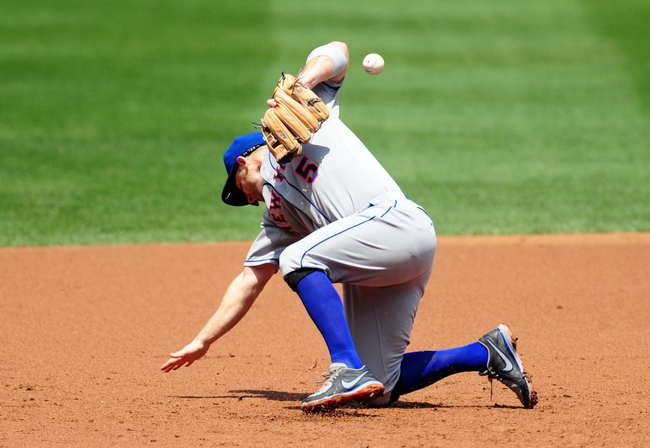 Jul 26, 2013; Washington, DC, USA; New York Mets third baseman David Wright (5) has the ball bounce off him on a base hit in the second inning against the Washington Nationals at Nationals Park. Mandatory Credit: Evan Habeeb-USA TODAY Sports