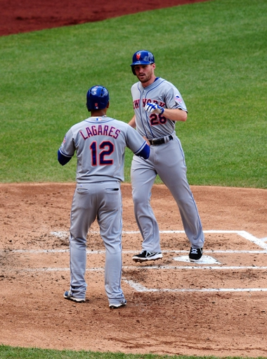 Jul 26, 2013; Washington, DC, USA; New York Mets second baseman Daniel Murphy (28) is congratulated by outfielder Juan Lagares (12) after hitting a home run in the third inning against the Washington Nationals at Nationals Park. Mandatory Credit: Evan Habeeb-USA TODAY Sports