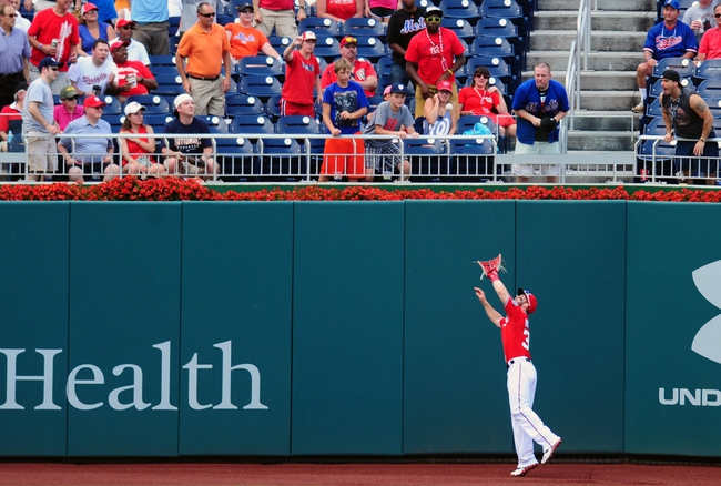 Jul 26, 2013; Washington, DC, USA; Washington Nationals outfielder Bryce Harper (34) catches a fly ball off the bat of New York Mets third baseman David Wright (not pictured) in the third inning at Nationals Park. Mandatory Credit: Evan Habeeb-USA TODAY Sports