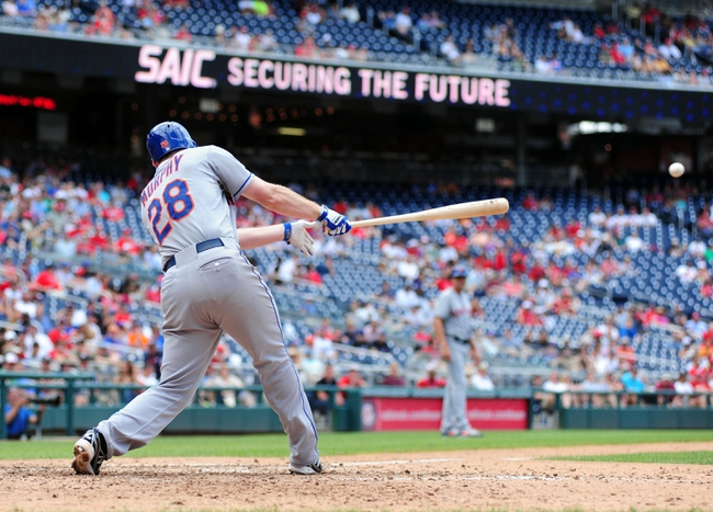 Jul 26, 2013; Washington, DC, USA; New York Mets second baseman Daniel Murphy (28) hits an RBI single in the ninth inning against the Washington Nationals at Nationals Park. Mandatory Credit: Evan Habeeb-USA TODAY Sports