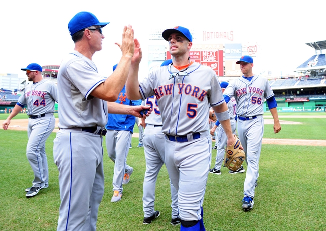 Jul 26, 2013; Washington, DC, USA; New York Mets third baseman David Wright (5) high fives teammates after beating the Washington Nationals 11-0 at Nationals Park. Mandatory Credit: Evan Habeeb-USA TODAY Sports