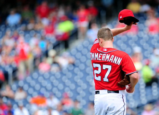 Jul 26, 2013; Washington, DC, USA; Washington Nationals pitcher Jordan Zimmermann (27) wipes sweat off his face during the game against the New York Mets at Nationals Park. Mandatory Credit: Evan Habeeb-USA TODAY Sports