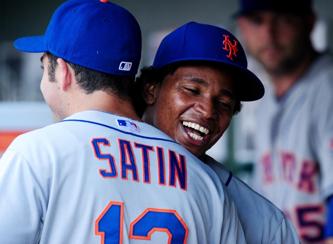 Jul 26, 2013; Washington, DC, USA; New York Mets pitcher Jenrry Mejia (right) is congratulated by teammate Josh Satin (left) after coming out of the game against the Washington Nationals at Nationals Park. Mandatory Credit: Evan Habeeb-USA TODAY Sports