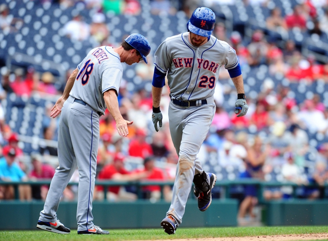 Jul 26, 2013; Washington, DC, USA; New York Mets first baseman Ike Davis (29) high fives third base coach Tim Teufel (18) after hitting a home run in the ninth inning against the Washington Nationals at Nationals Park. Mandatory Credit: Evan Habeeb-USA TODAY Sports