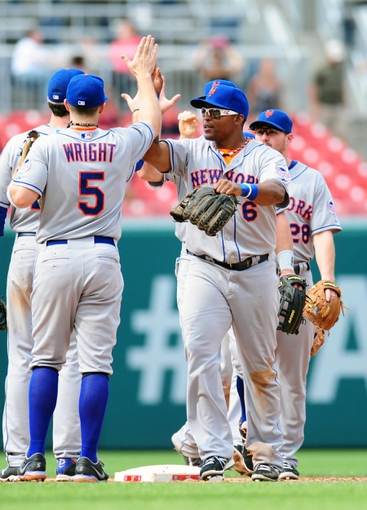 Jul 26, 2013; Washington, DC, USA; New York Mets outfielder Marlon Byrd (6) high fives third baseman David Wright (5) after beating the Washington Nationals 11-0 at Nationals Park. Mandatory Credit: Evan Habeeb-USA TODAY Sports