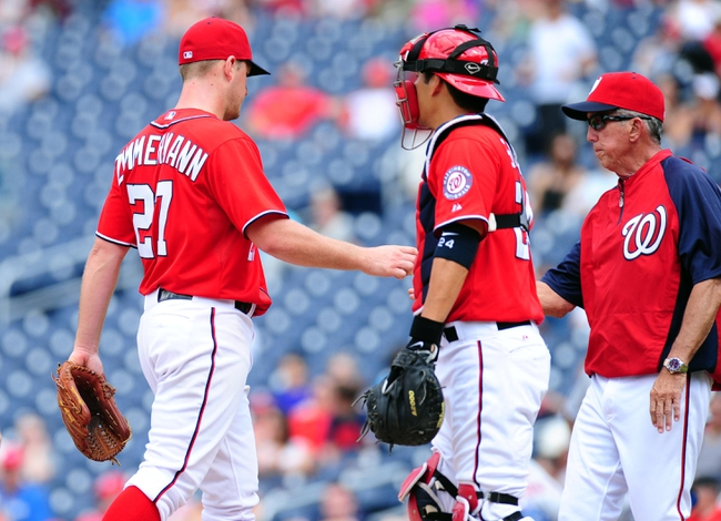 Jul 26, 2013; Washington, DC, USA; Washington Nationals manager Davey Johnson (right) takes the ball from pitcher Jordan Zimmermann (27) in the seventh inning against the New York Mets at Nationals Park. Mandatory Credit: Evan Habeeb-USA TODAY Sports