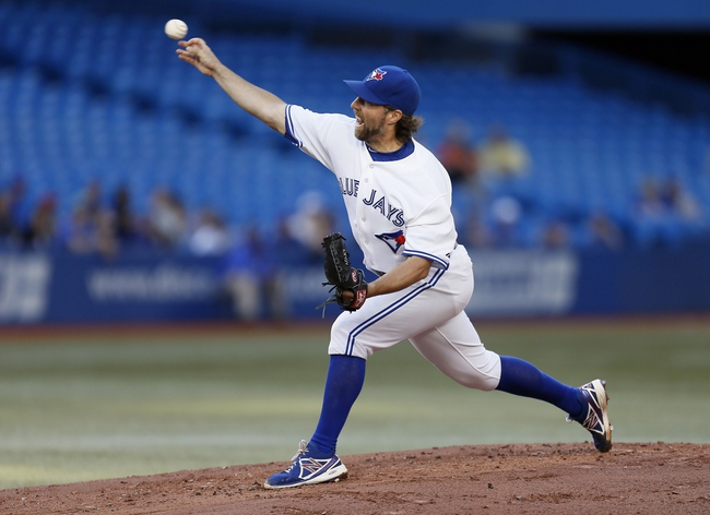 Jul 26, 2013; Toronto, Ontario, CAN; Toronto Blue Jays starting pitcher R.A. Dickey (43) throws against the Houston Astros  in the second inning at the Rogers Centre. Mandatory Credit: John E. Sokolowski-USA TODAY Sports