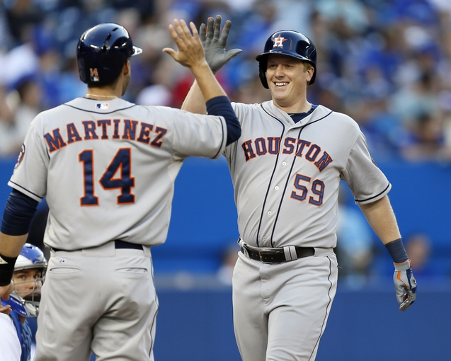 Jul 26, 2013; Toronto, Ontario, CAN; Houston Astros left fielder Marc Krauss (59) celebrates his two run home run with right fielder J.D. Martinez (14) during the second inning against the Toronto Blue Jays at the Rogers Centre. Mandatory Credit: John E. Sokolowski-USA TODAY Sports