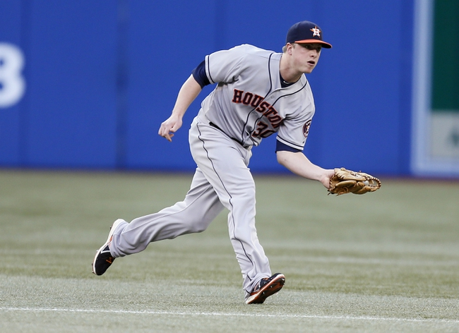 Jul 26, 2013; Toronto, Ontario, CAN; Houston Astros third baseman Matt Dominguez (30) makes a catch on an Toronto Blue Jays designated hitter Adam Lind (not pictured) hit in the third inning at the Rogers Centre. Mandatory Credit: John E. Sokolowski-USA TODAY Sports