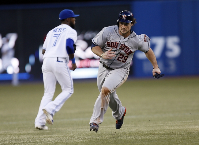 Jul 26, 2013; Toronto, Ontario, CAN; Houston Astros first baseman Brett Wallace (29) heads for third base on a double by right fielder J.D. Martinez (not pictured) in the fourth inning against the Toronto Blue Jays at the Rogers Centre. Mandatory Credit: John E. Sokolowski-USA TODAY Sports