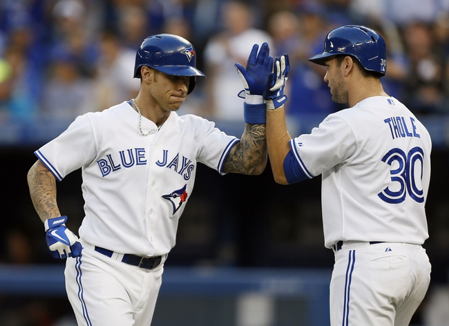 Jul 26, 2013; Toronto, Ontario, CAN; Toronto Blue Jays third baseman Brett Lawrie (13) celebrates his solo home with catcher Josh Thole (30) in the fourth inning against the Houston Astros  at the Rogers Centre. Mandatory Credit: John E. Sokolowski-USA TODAY Sports