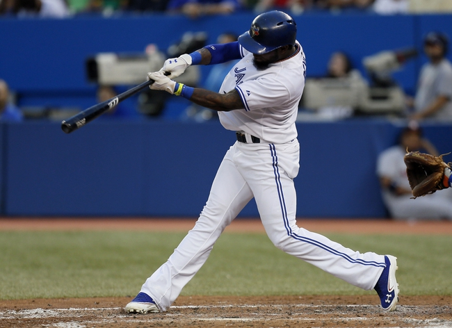 Jul 26, 2013; Toronto, Ontario, CAN; Toronto Blue Jays shortstop Jose Reyes (7) singles in the fourth inning against the Houston Astros at the Rogers Centre. Mandatory Credit: John E. Sokolowski-USA TODAY Sports