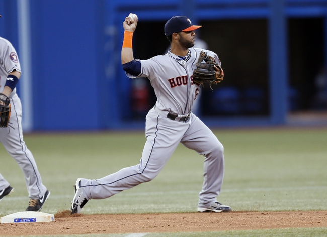 Jul 26, 2013; Toronto, Ontario, CAN; Houston Astros shortstop Jonathan Villar (6) turns a double play in the fourth inning against the Toronto Blue Jays  at the Rogers Centre. Mandatory Credit: John E. Sokolowski-USA TODAY Sports