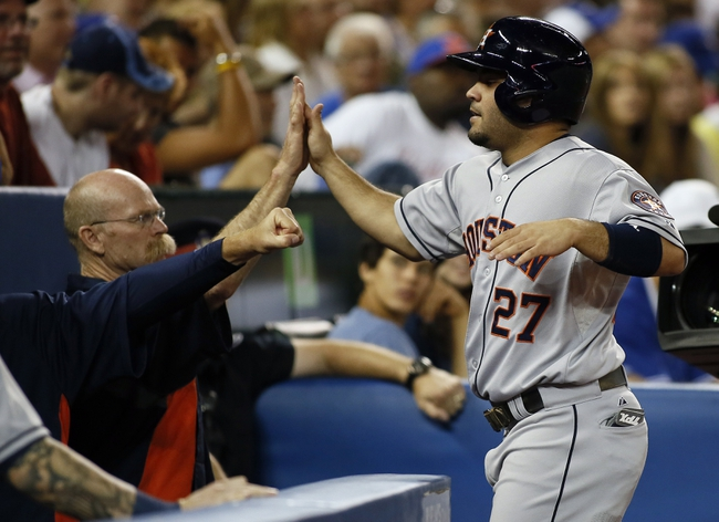 Jul 26, 2013; Toronto, Ontario, CAN; Houston Astros second baseman Jose Altuve (27) gets congratulated after scoring a run in the seventh inning against the Toronto Blue Jays at the Rogers Centre. Mandatory Credit: John E. Sokolowski-USA TODAY Sports
