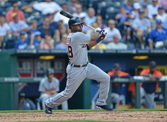 July 21, 2013; Kansas City, MO, USA; Detroit Tigers left fielder Torii Hunter (48) at bat against the Kansas City Royals during the sixth inning at Kauffman Stadium.  Mandatory Credit: Peter G. Aiken-USA TODAY Sports