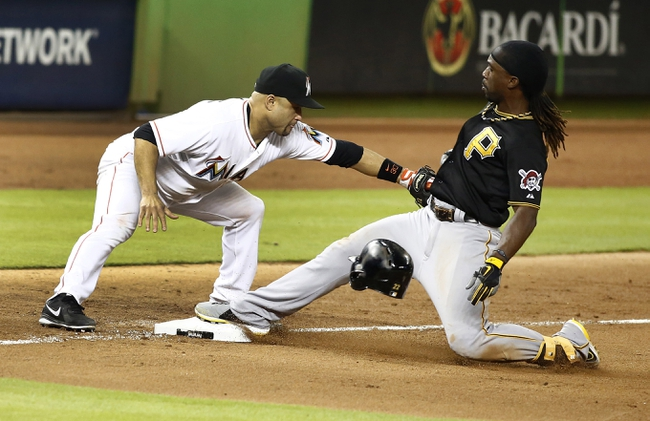 Jul 27, 2013; Miami, FL, USA; Pittsburgh Pirates center fielder Andrew McCutchen is safe on a triple in the eighth inning as Miami Marlins third baseman Placido Polanco is late with the tag at Marlins Park. The Pirates won 7-4. Mandatory Credit: Robert Mayer-USA TODAY Sports