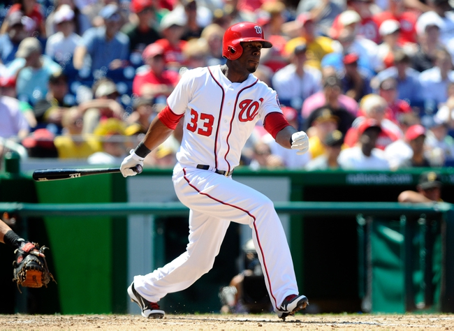 Jul 25, 2013; Washington, DC, USA; Washington Nationals outfielder Roger Bernadina (33) bats during the game against the Pittsburg Pirates at Nationals Park. Mandatory Credit: Brad Mills-USA TODAY Sports