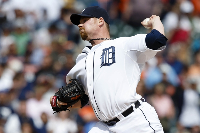 Jul 28, 2013; Detroit, MI, USA; Detroit Tigers relief pitcher Phil Coke (40) pitches in the ninth inning against the Philadelphia Phillies at Comerica Park. Detroit won 12-4. Mandatory Credit: Rick Osentoski-USA TODAY Sports