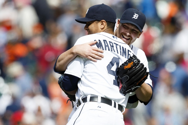 Jul 28, 2013; Detroit, MI, USA; Detroit Tigers first baseman Victor Martinez (41) and relief pitcher Phil Coke (40) hug after the game against the Philadelphia Phillies at Comerica Park. Detroit won 12-4. Mandatory Credit: Rick Osentoski-USA TODAY Sports