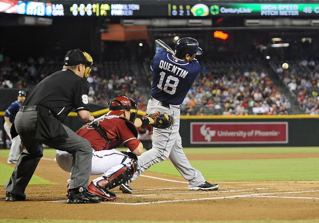 Jul 28, 2013; Phoenix, AZ, USA; San Diego Padres outfielder Carlos Quentin (18) hits an RBI single against the Arizona Diamondbacks in the first inning at Chase Field. Mandatory Credit: Jennifer Stewart-USA TODAY Sports