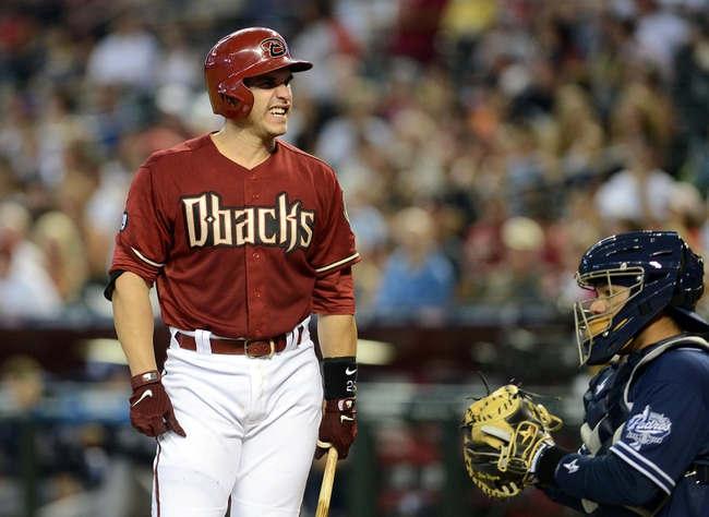 Jul 28, 2013; Phoenix, AZ, USA; Arizona Diamondbacks catcher Miguel Montero (26) reacts to a strike call in the second inning of the game against the San Diego Padres at Chase Field.  Mandatory Credit: Jennifer Stewart-USA TODAY Sports