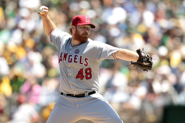 Jul 28, 2013; Oakland, CA, USA; Los Angeles Angels pitcher Tommy Hanson (48) prepares to deliver a pitch against the Oakland Athletics in the third inning at O.co Coliseum. Mandatory Credit: Cary Edmondson-USA TODAY Sports