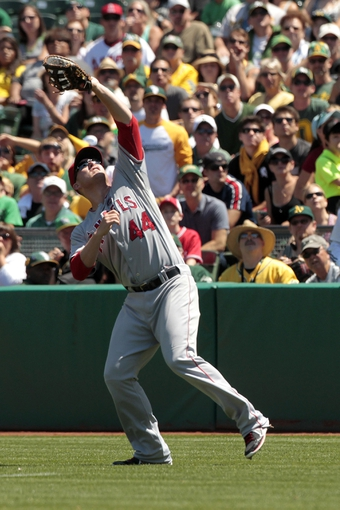 Jul 28, 2013; Oakland, CA, USA; Los Angeles Angels infielder Mark Trumbo (44) makes a catch in foul territory against the Oakland Athletics in the third inning at O.co Coliseum. Mandatory Credit: Cary Edmondson-USA TODAY Sports