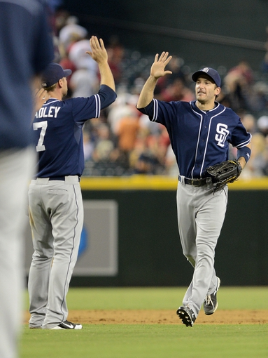 Jul 28, 2013; Phoenix, AZ, USA; San Diego Padres outfielder Chris Denorfia (13) celebrates with infielder Chase Headley (7) after defeating the Arizona Diamondbacks in the ninth inning at Chase Field. The Padres defeated the Diamondbacks 1-0. Mandatory Credit: Jennifer Stewart-USA TODAY Sports