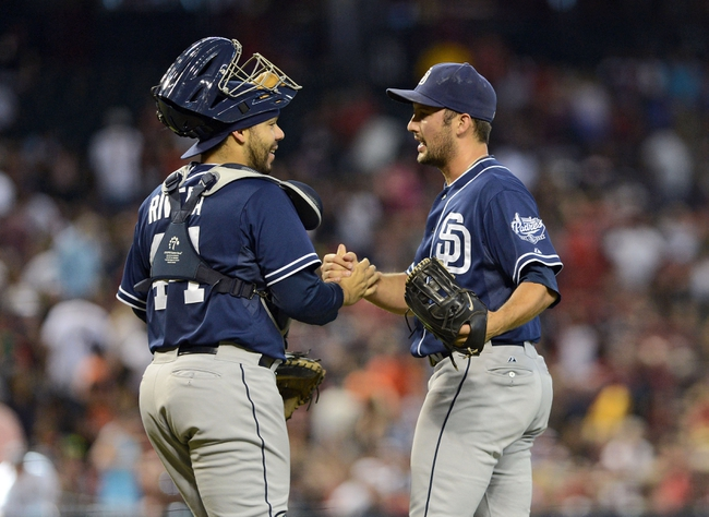 Jul 28, 2013; Phoenix, AZ, USA; San Diego Padres pitcher Huston Street (16) is congratulated by catcher Rene Rivera (44) after defeating the Arizona Diamondbacks in the ninth inning at Chase Field. The Padres defeated the Diamondbacks 1-0. Mandatory Credit: Jennifer Stewart-USA TODAY Sports